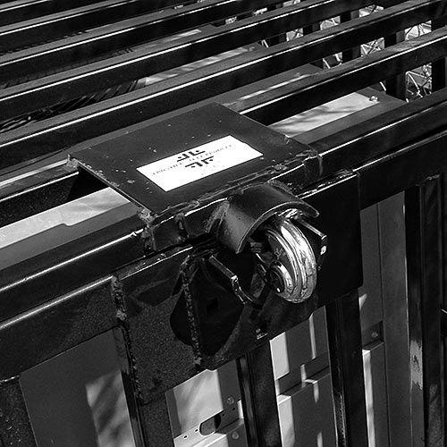 close up of lock on ac enclosure around commercial ac unit