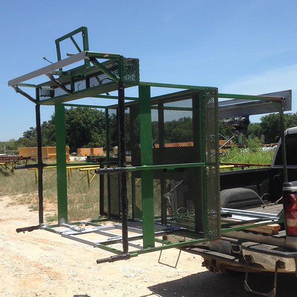 custom steel hunting platform hinged so it can stay in pickup to park in garage